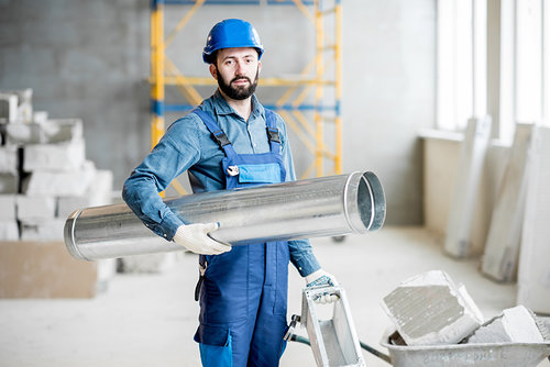 Builder with pipe indoors